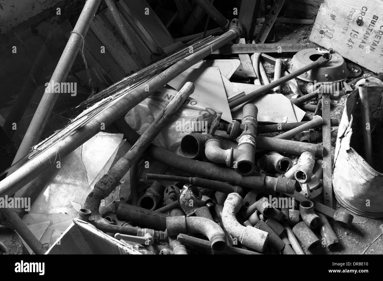 old pipes and fittings from an old cow shed in Finland. - Stock Image