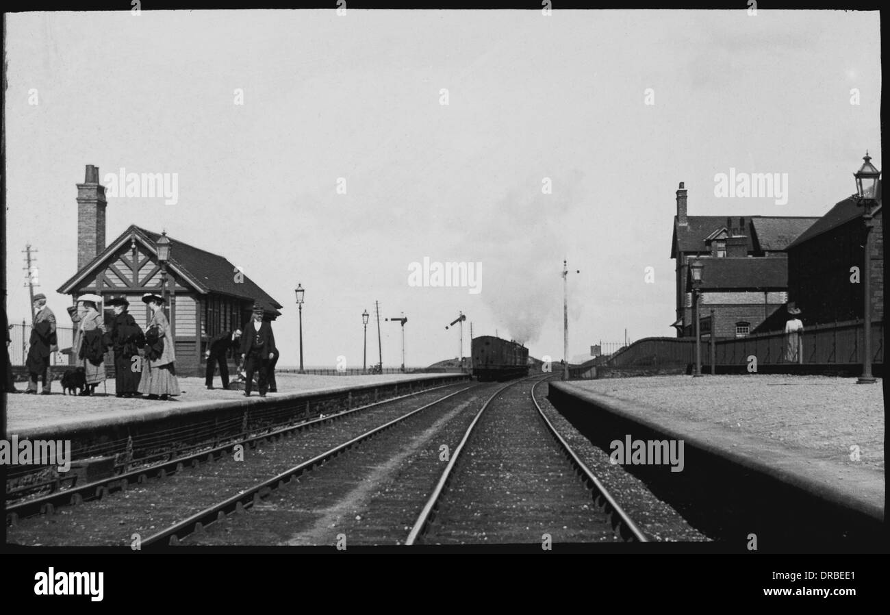 Passenger train leaving Seascale Station, Cumbria (then in the county of Cumberland) in 1904. Stock Photo