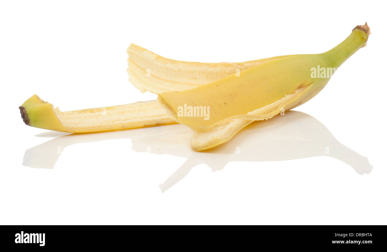 an eaten banana with peel left on a isolated white background - Stock Image