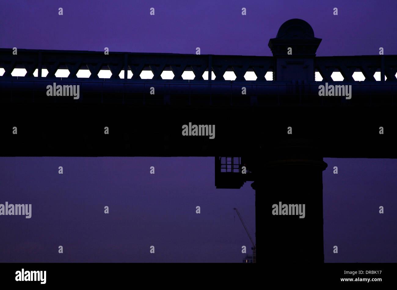 District Line tube train crossing the Fulham Rail Bridge at dusk, Putney, London, UK - Stock Image