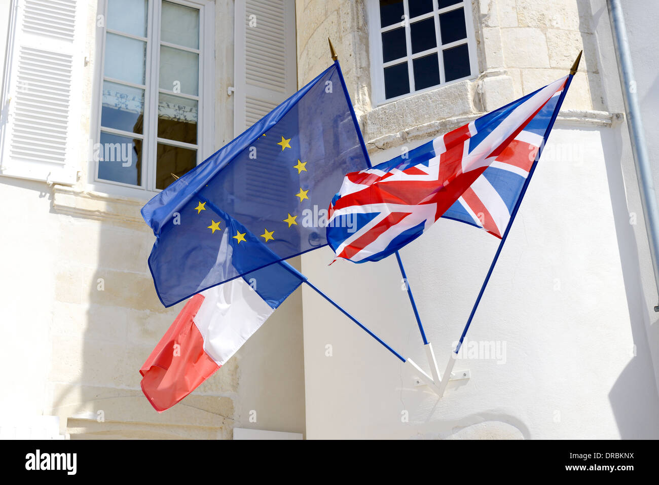 three flags fly together unity of france and england throught the european union Stock Photo