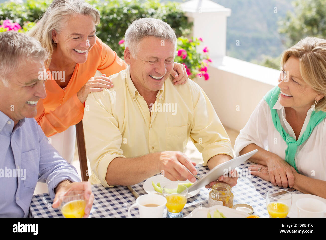 Older couples using digital tablet - Stock Image