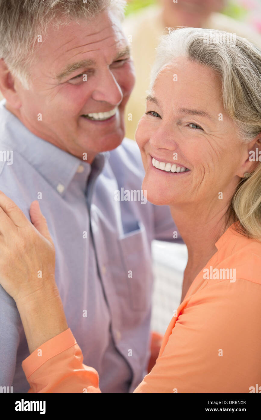 Happy senior couple hugging - Stock Image