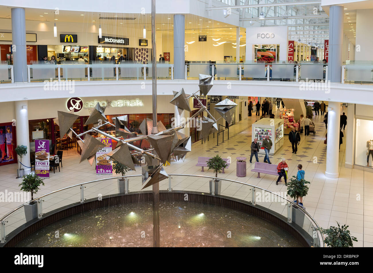 Interior of the Designer shopping mall, with the central foyer's water fountain, Livingstone, Edinburgh, Scotland, Great Britain - Stock Image