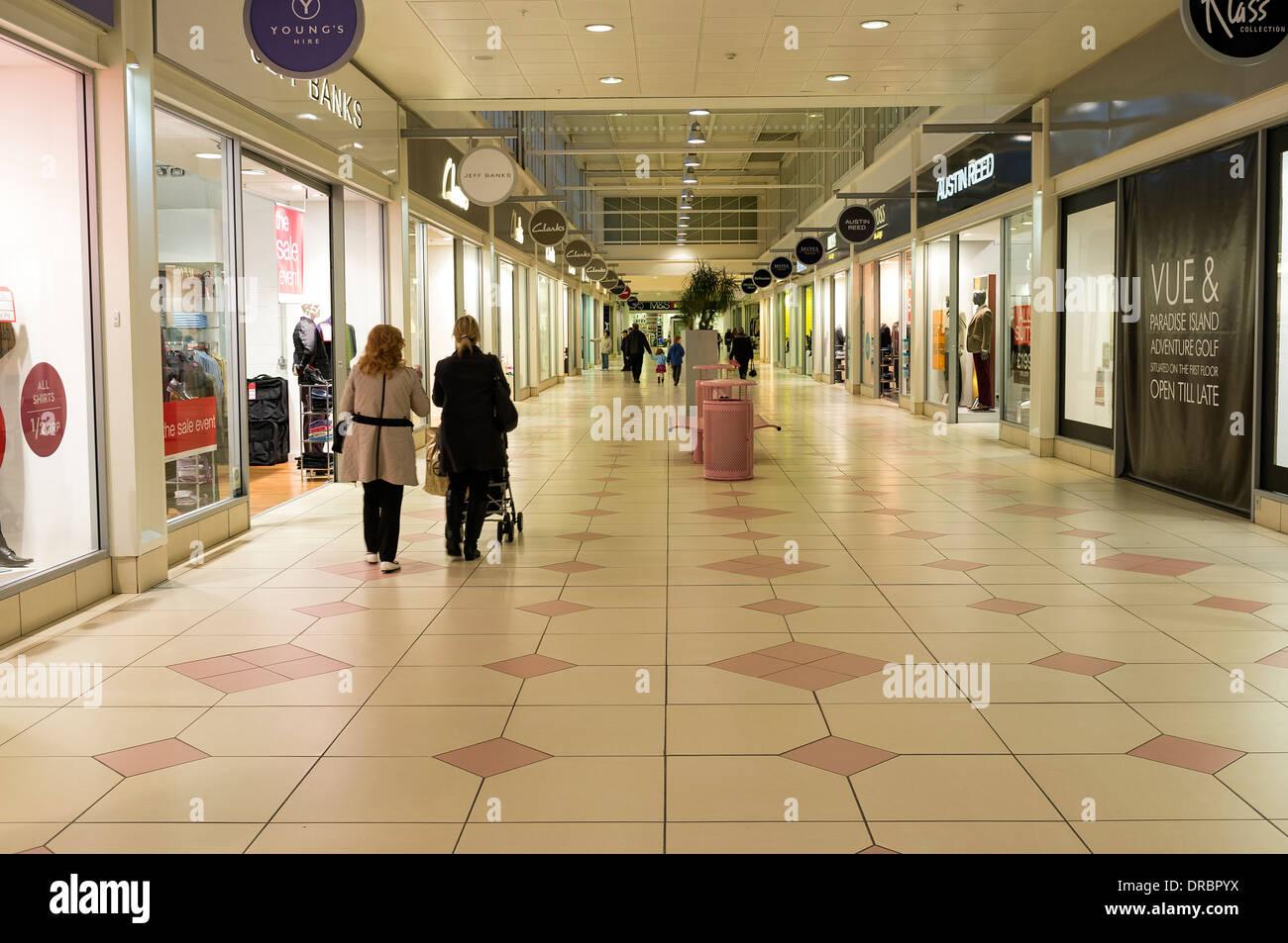 Interior walkway between shops at the Livingston Designer shopping mall, near Edinburgh, Scotland, Great Britain, UK - Stock Image