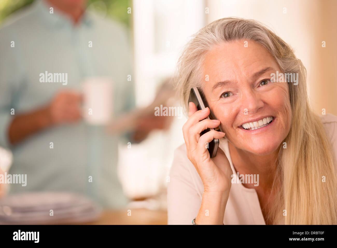 Senior woman talking on cell phone - Stock Image