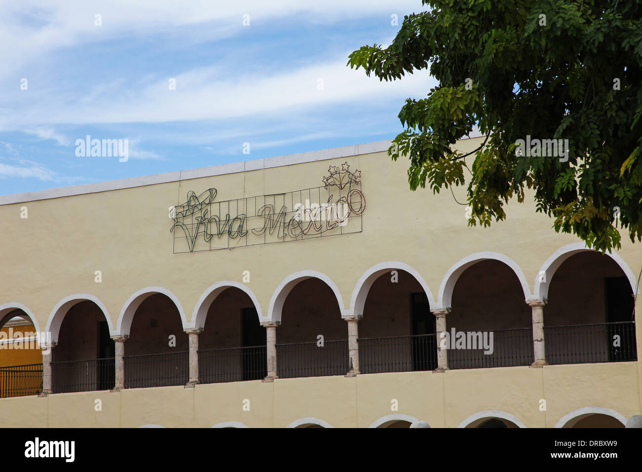 A neon sign (unlit) saying Viva Mexico on the side of a building Valladolid Mexico - Stock Image