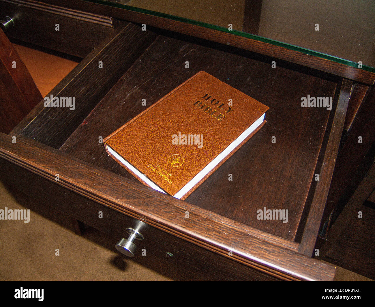 Hotel room drawer with Holy Bible - Stock Image