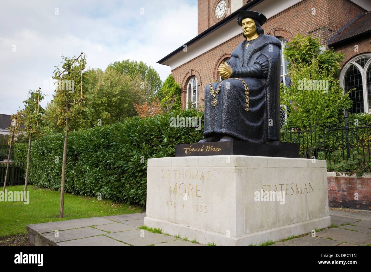 The statue of Sir Thomas Moore outside Chelsea Old Church, London, UK. - Stock Image