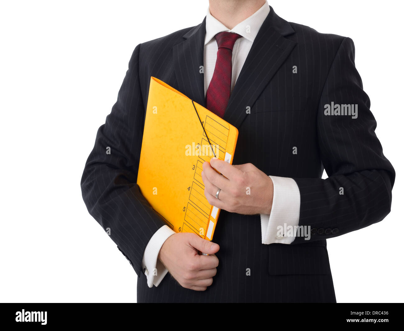 A businessman holding on a folder isolated on white - Stock Image