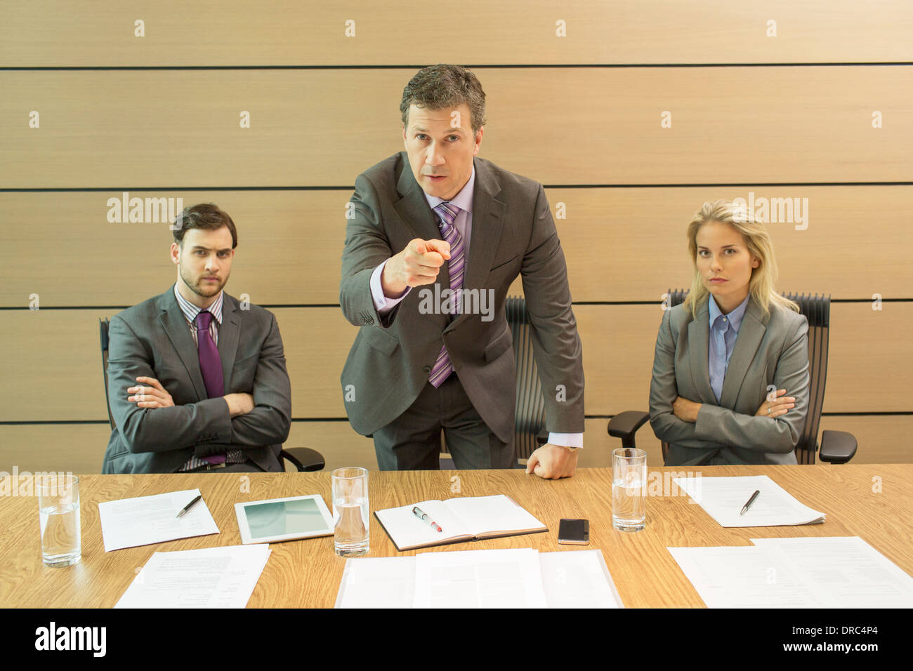 Businessman shaking his finger in meeting - Stock Image