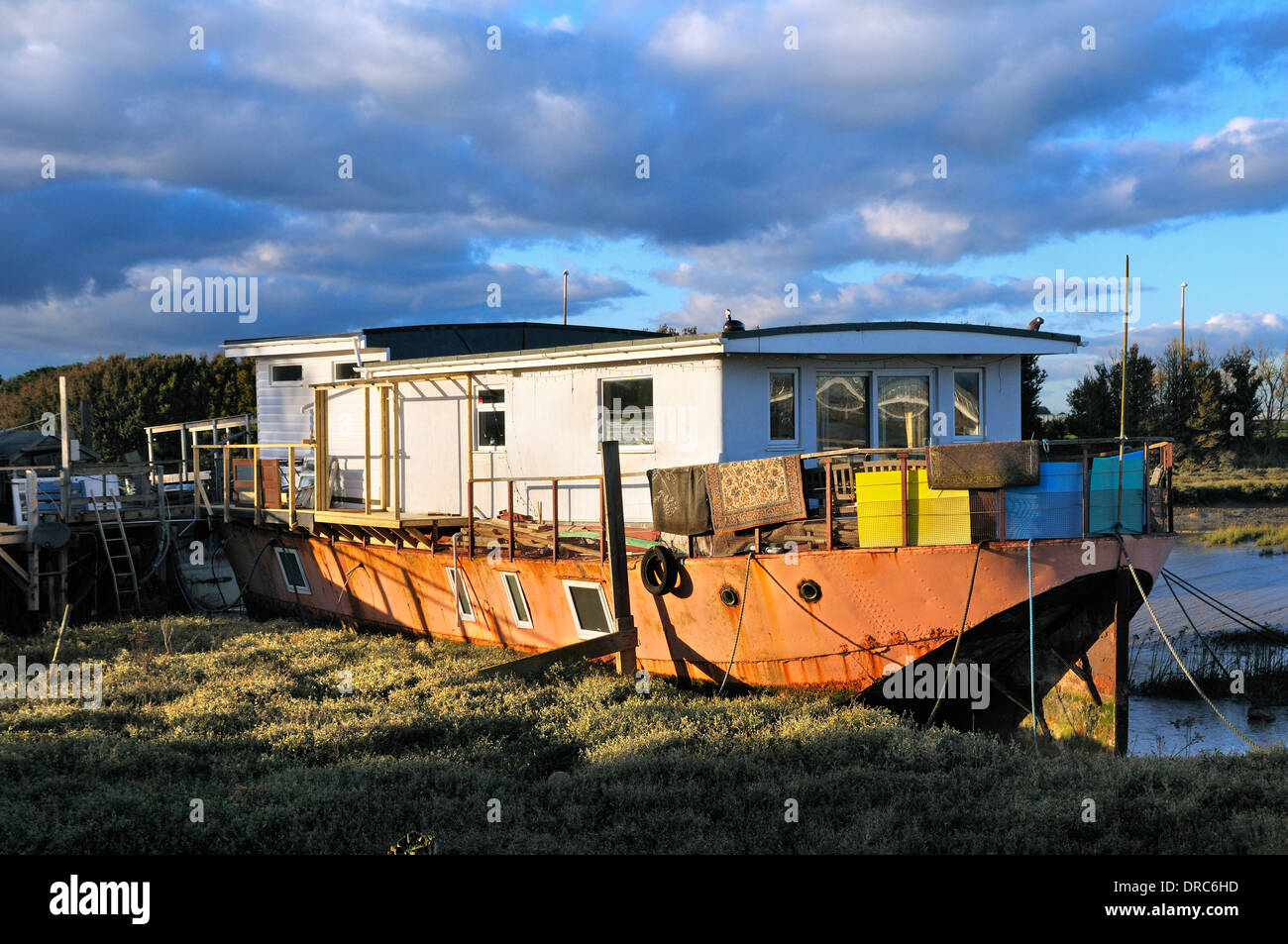 Houseboat on the banks of the river Adur, Shoreham-by-Sea, West Sussex, England, UK Stock Photo