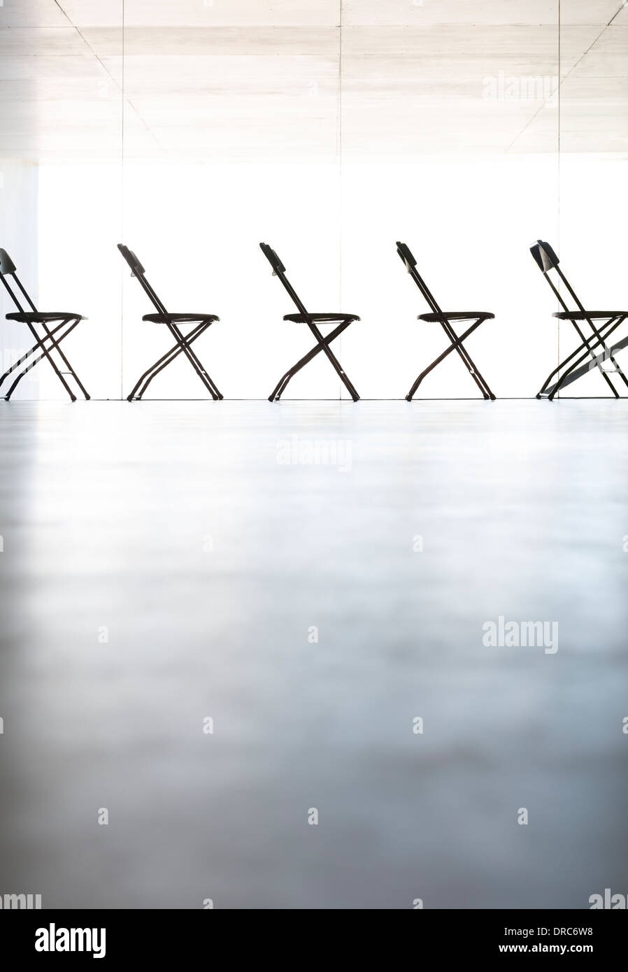 Chairs lined up in a row in office - Stock Image