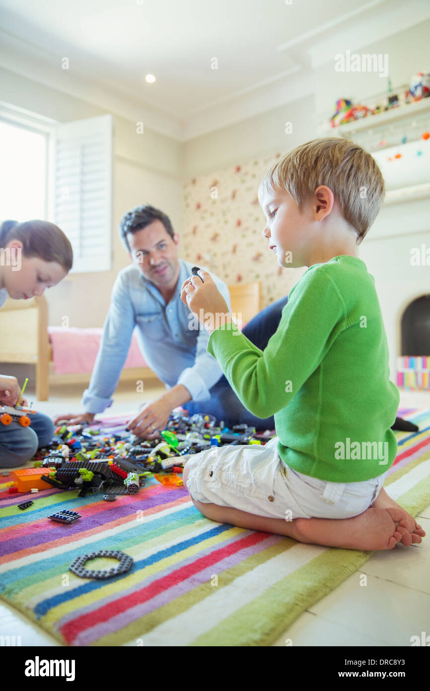Father playing with children - Stock Image