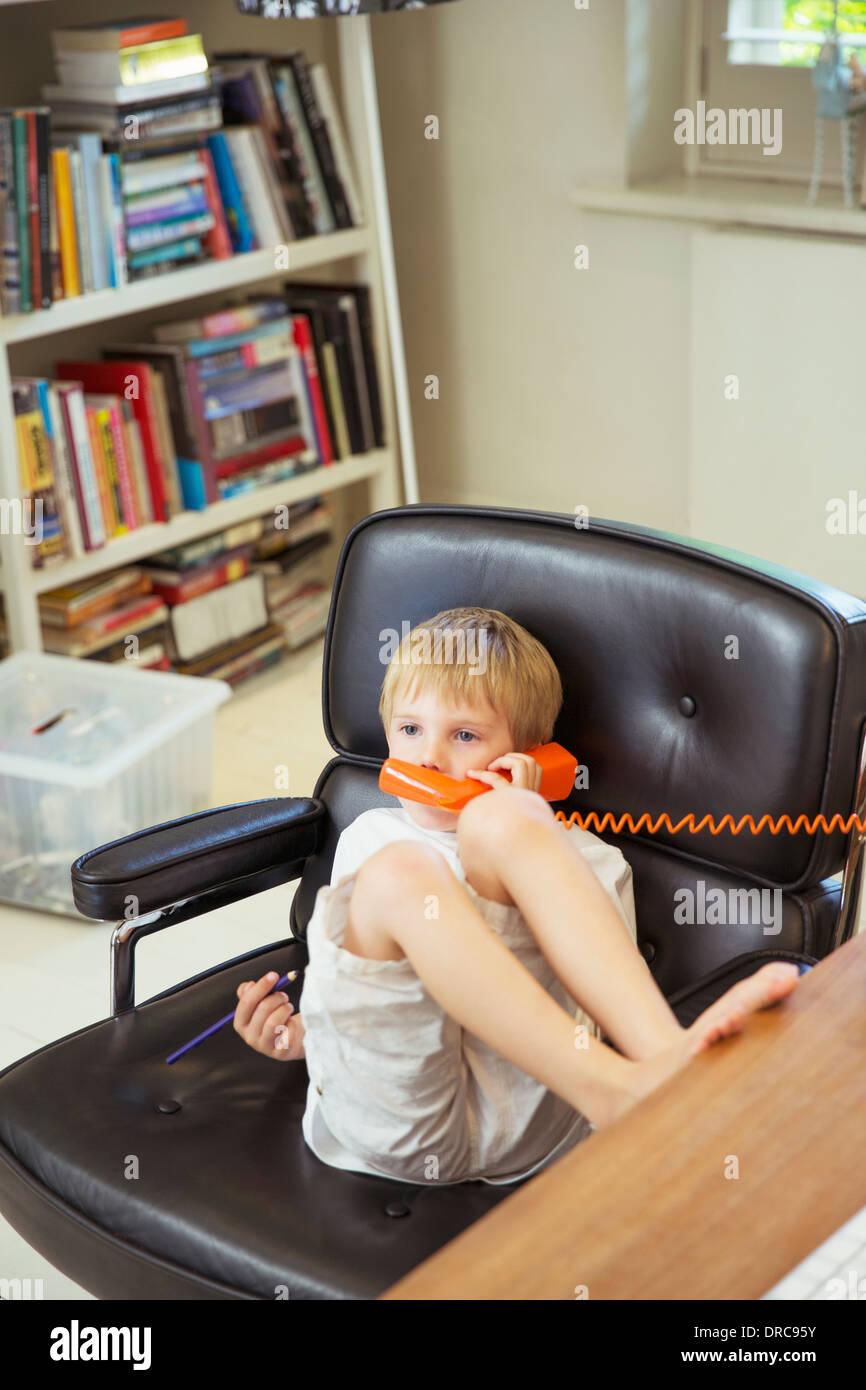 Boy talking on telephone - Stock Image