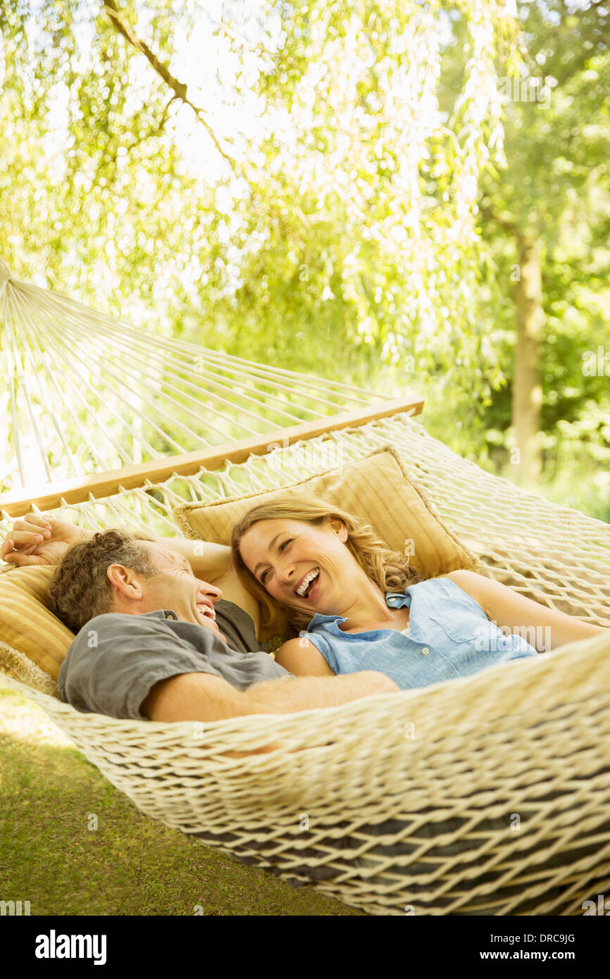 Couple relaxing in hammock outdoors - Stock Image