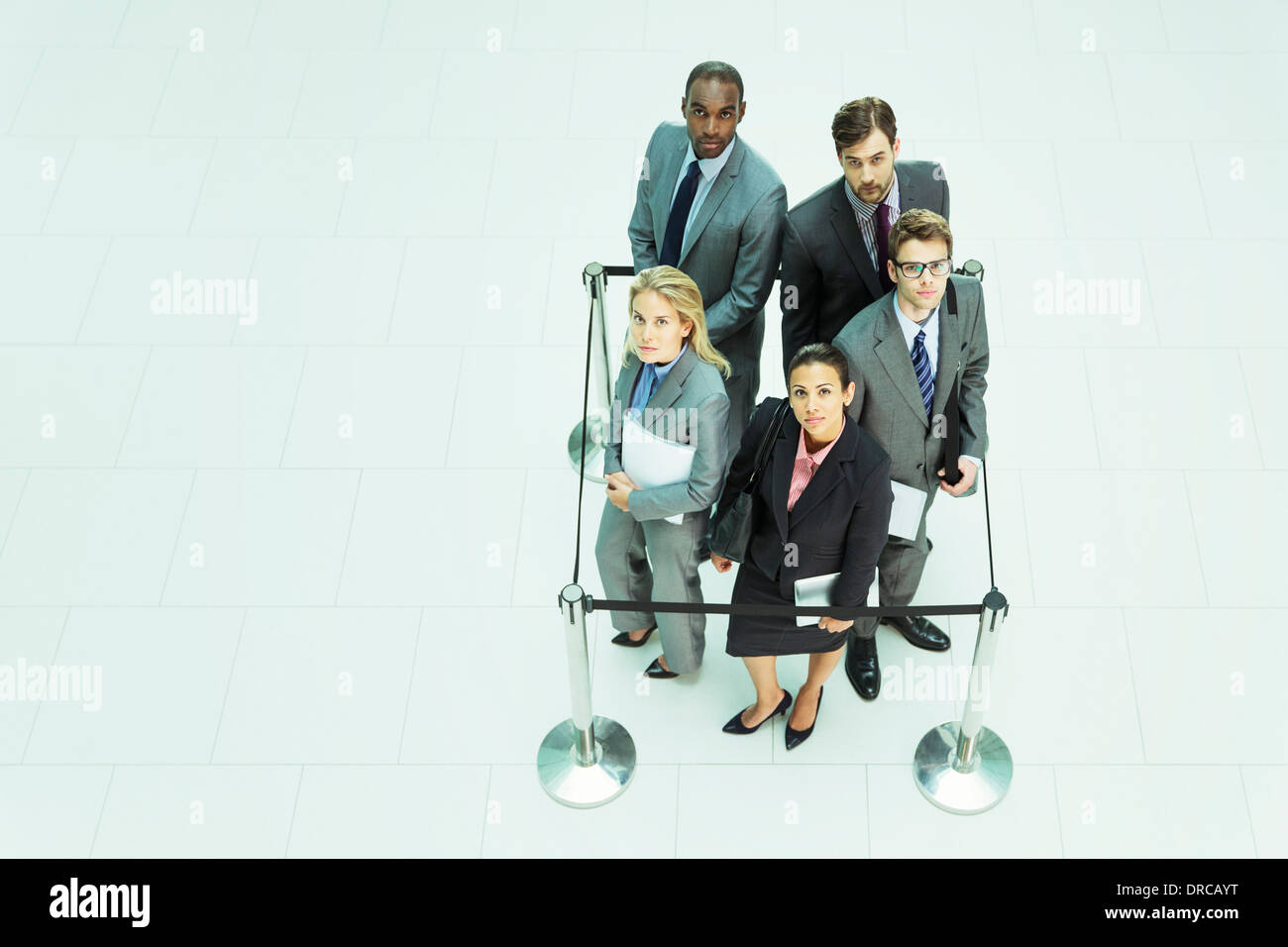 Business people standing in roped-off square Stock Photo