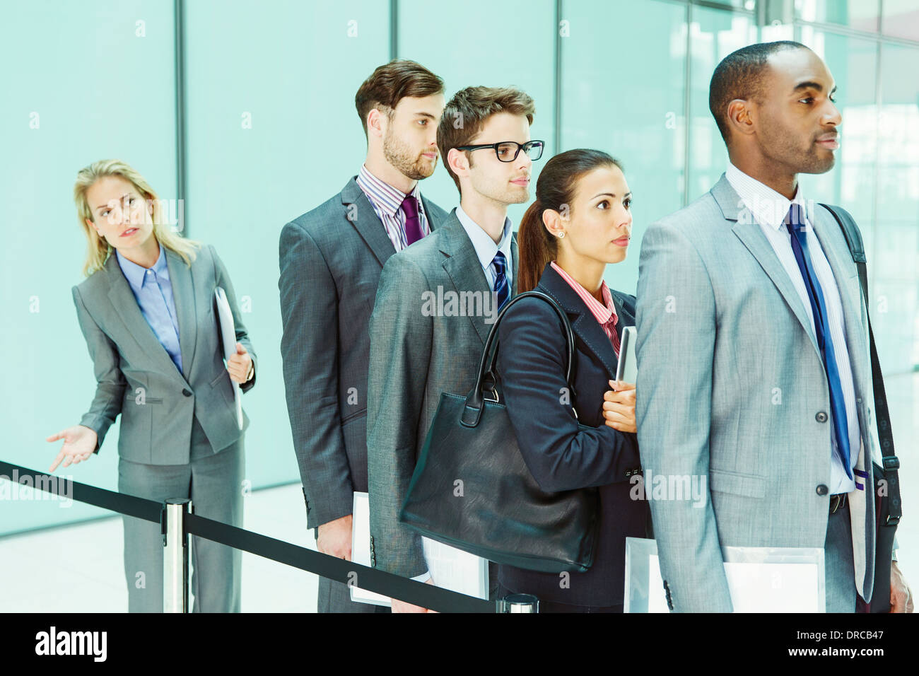 Business people waiting in line - Stock Image
