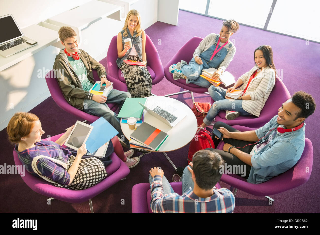 University students talking in circle - Stock Image