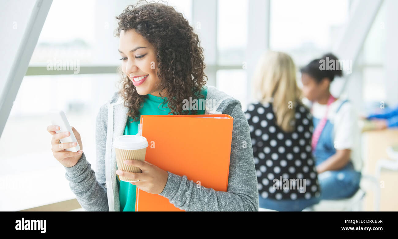 University student using cell phone - Stock Image
