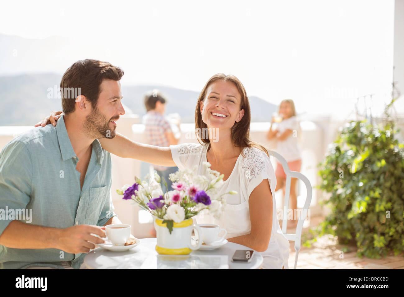 Couple enjoying coffee on balcony - Stock Image