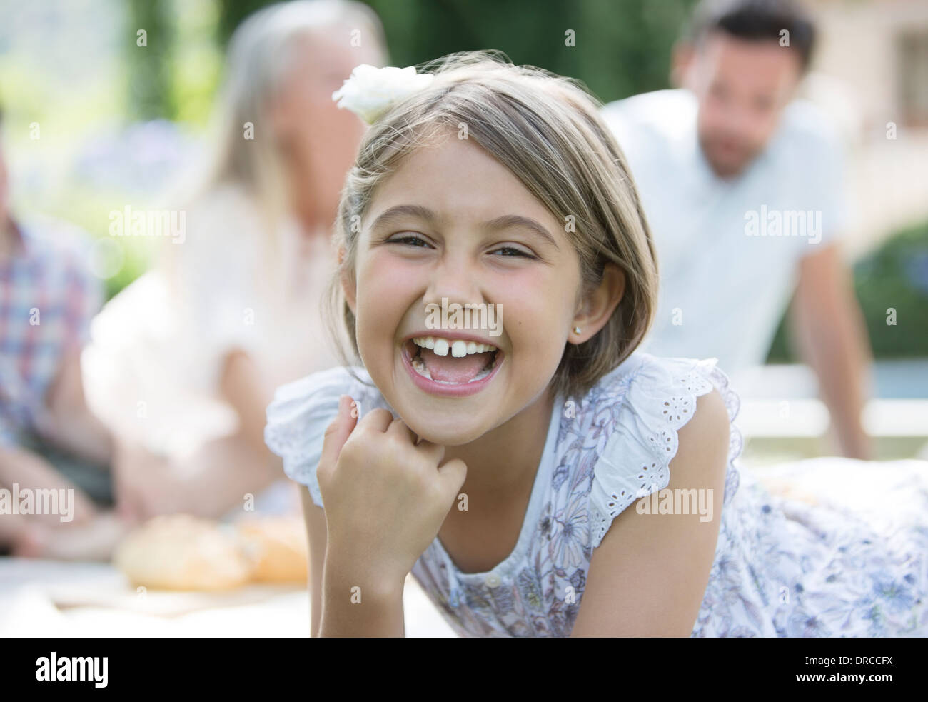 Girl laughing outdoors - Stock Image
