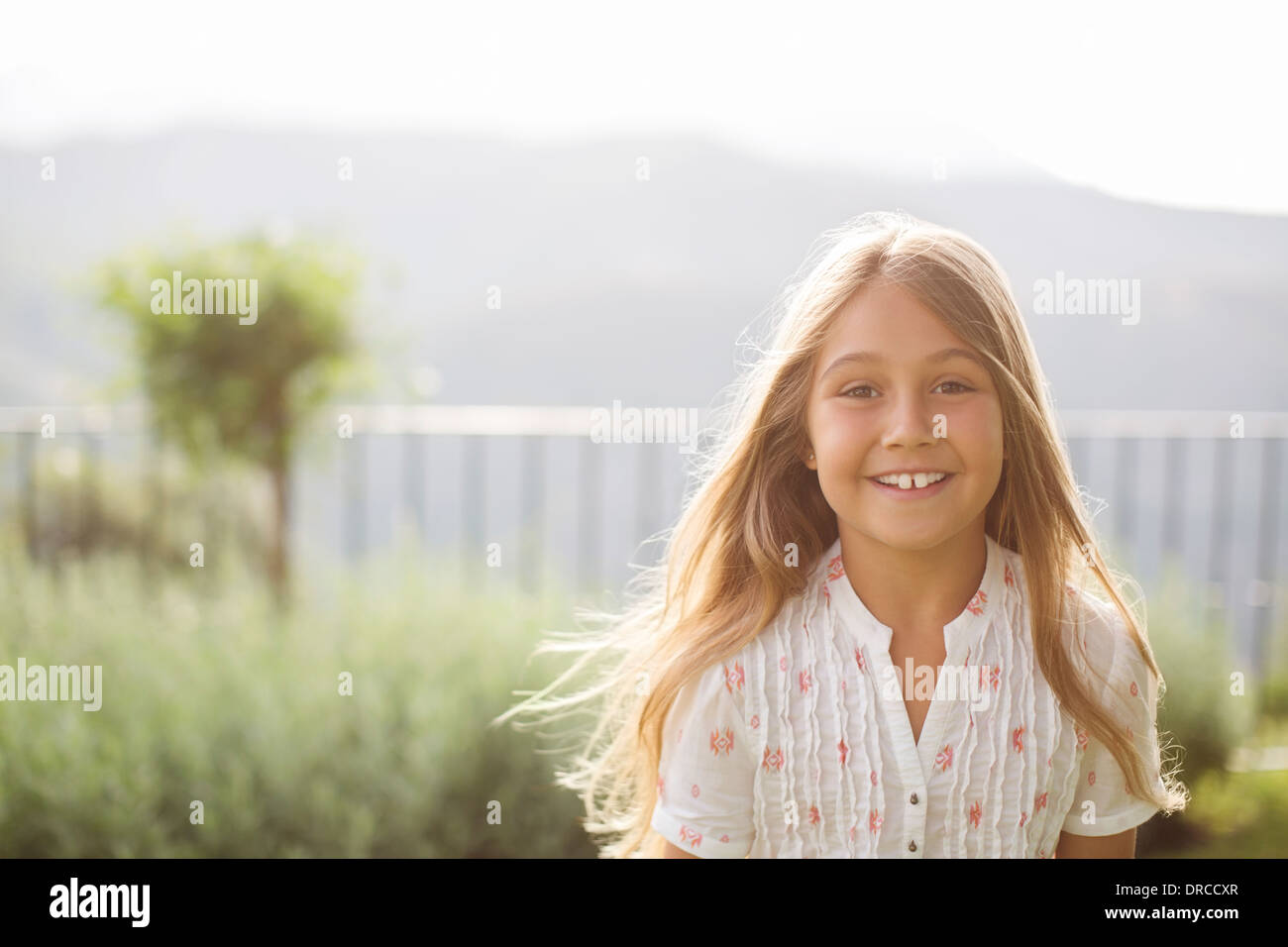Girl smiling outdoors - Stock Image