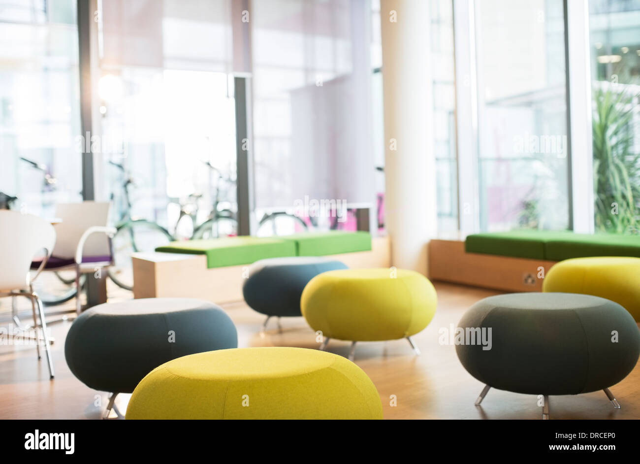 Chairs and tables in empty lounge - Stock Image