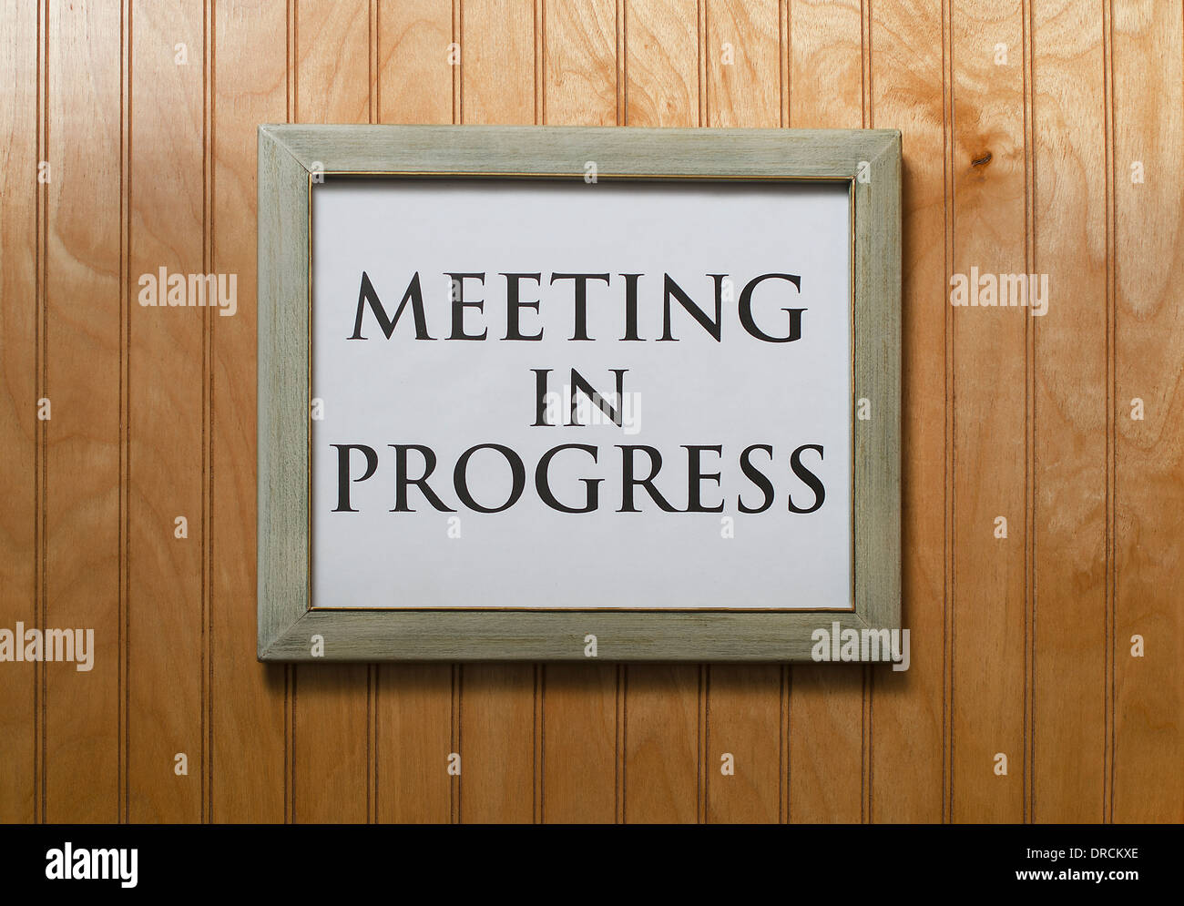 meeting in progress sign on wall - Stock Image