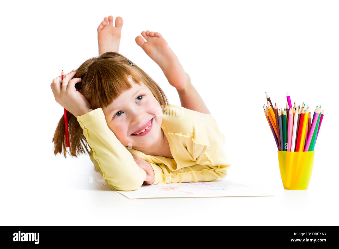 kid girl drawing with pencils - Stock Image