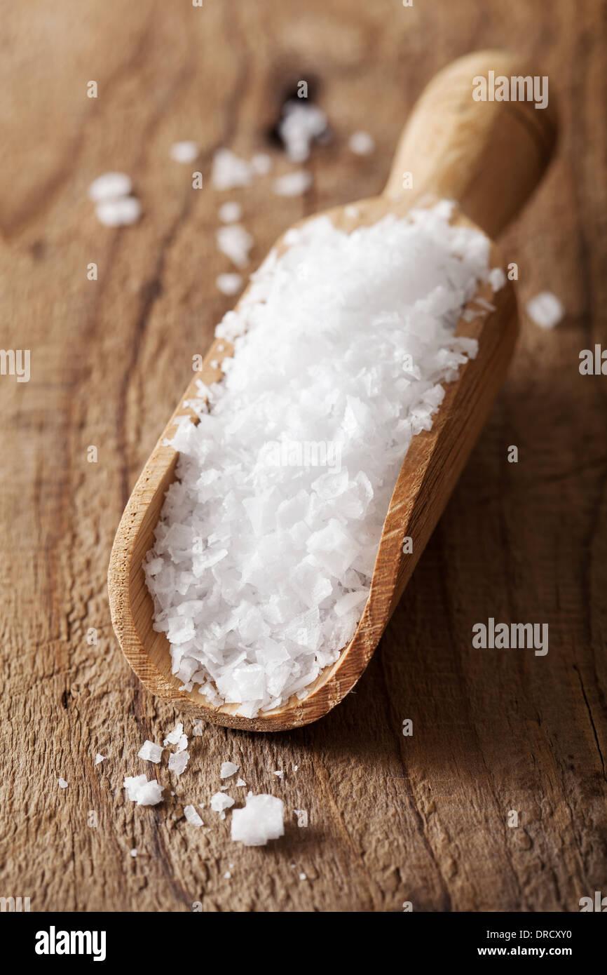sea salt in wooden scoop - Stock Image