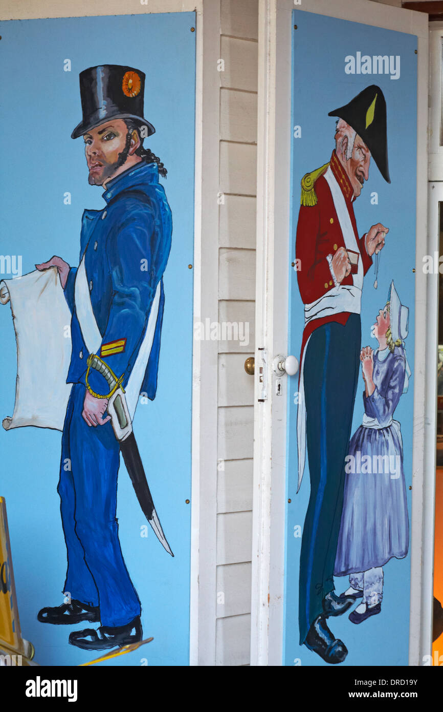 paintings of Royal Marine Officer and young girl on outside of store at Portsmouth Historic Dockyard - Stock Image