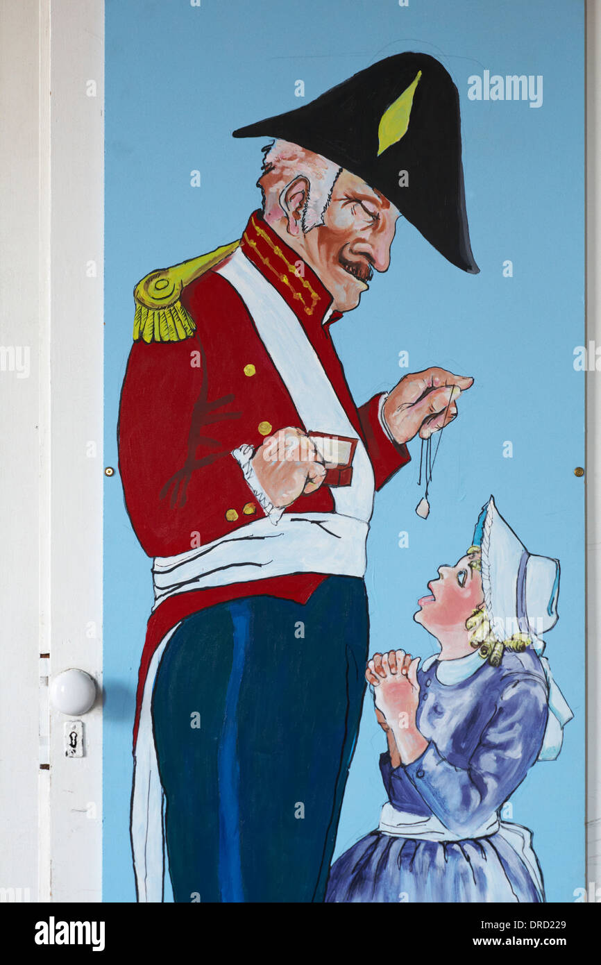 painting of Royal Marine Officer and young girl on outside of store at Portsmouth Historic Dockyard - Stock Image