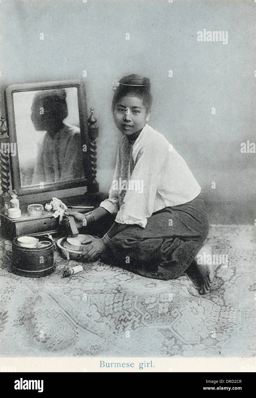A Burmese girl preparing her make-up - Stock Image
