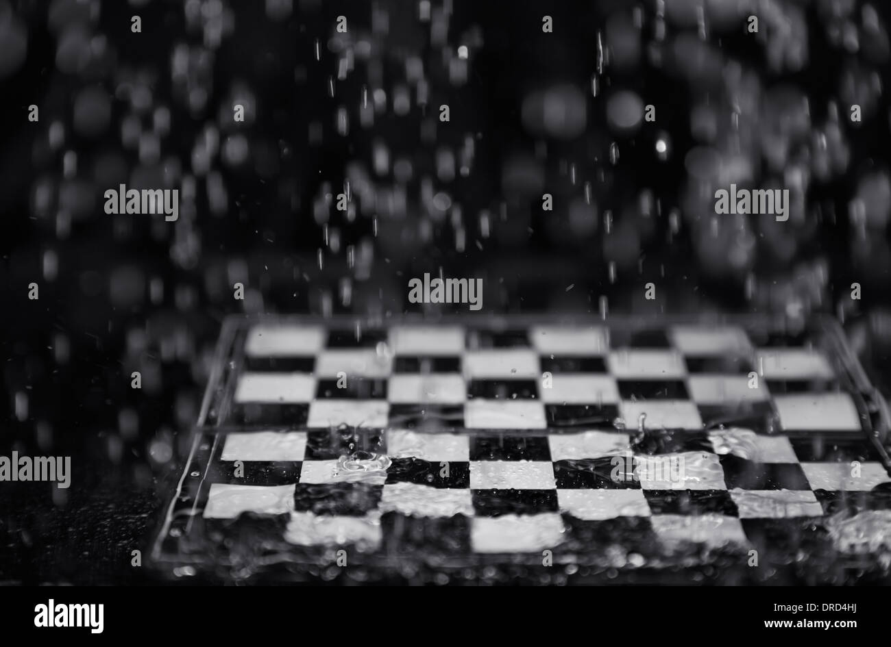 Chessboard under the rain. Close-up view - Stock Image