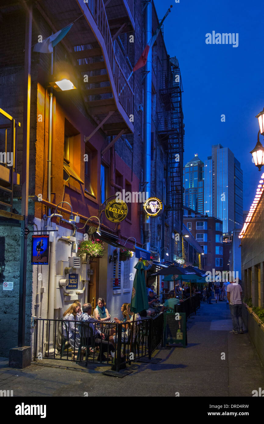 Bars and restaurants at night, Post Alley behind Pike Place Market, Seattle, Washington, USA - Stock Image