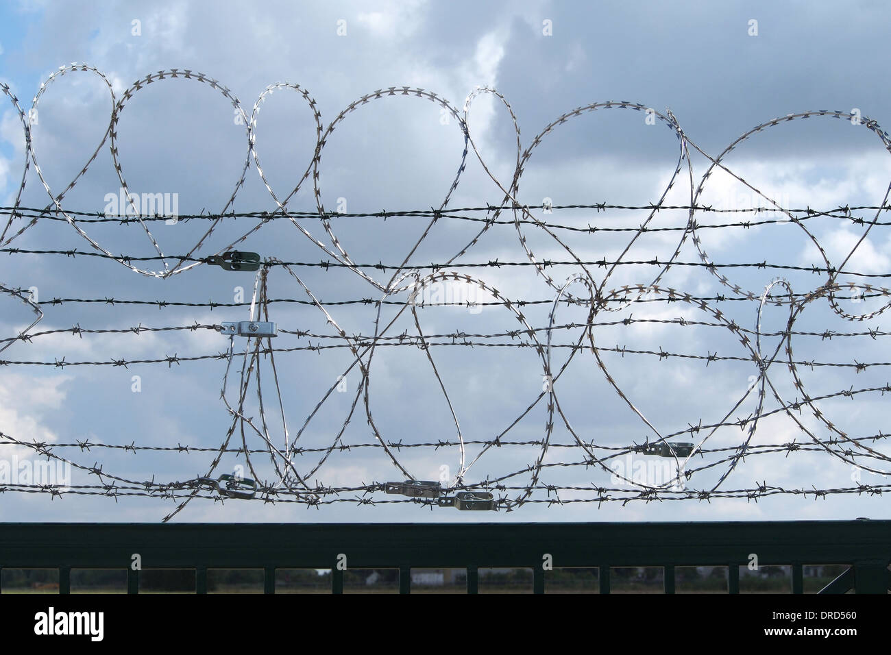 Restricted area - fence with barbed wire - Stock Image