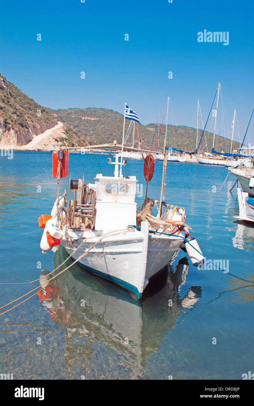 Brightly coloured blue and red fishing boat in harbour, Fiskardo Kefallonia Greece - Stock Image