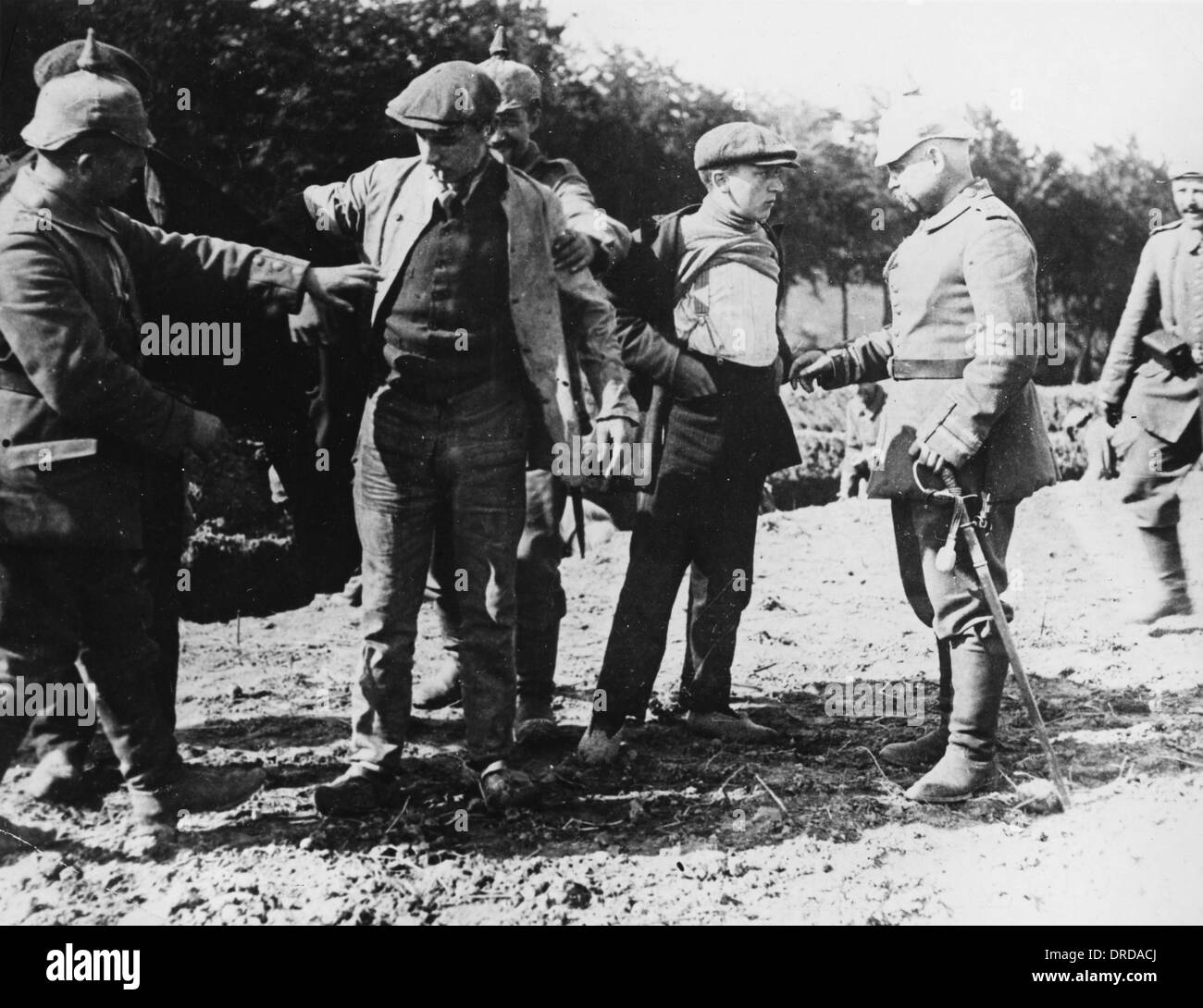 Belgian civilians searched WWI - Stock Image