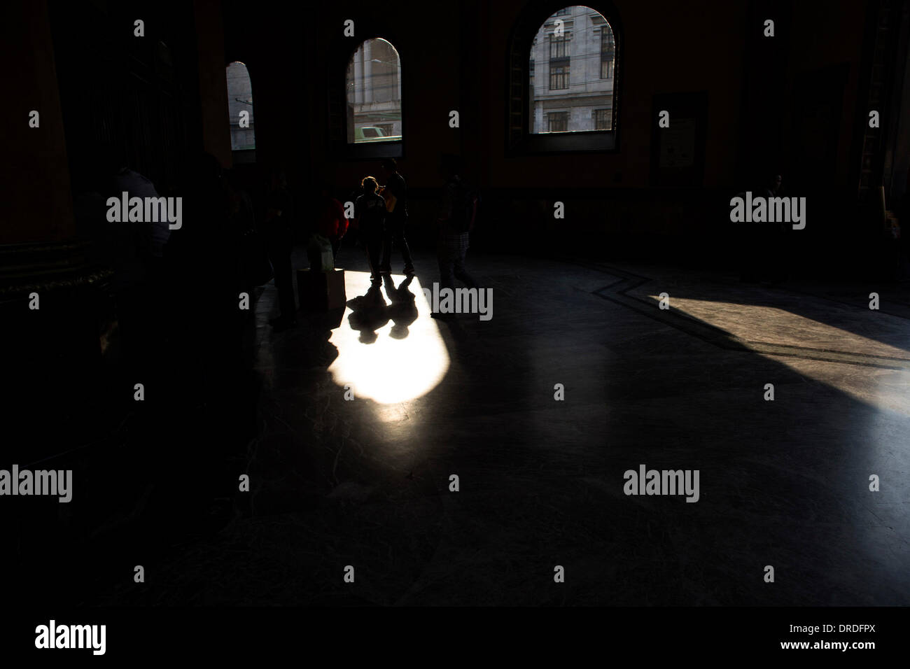 Mexico City. 23rd Jan, 2014. Image taken on Jan. 22, 2014 shows people walking inside the Postal Palace, in Mexico City's Historic Center, capital of Mexico. Mexico City's Historic Center has a rich architecture that brings together different styles of the colonial and contemporary eras in the same space. © Guillermo Arias/Xinhua/Alamy Live News - Stock Image