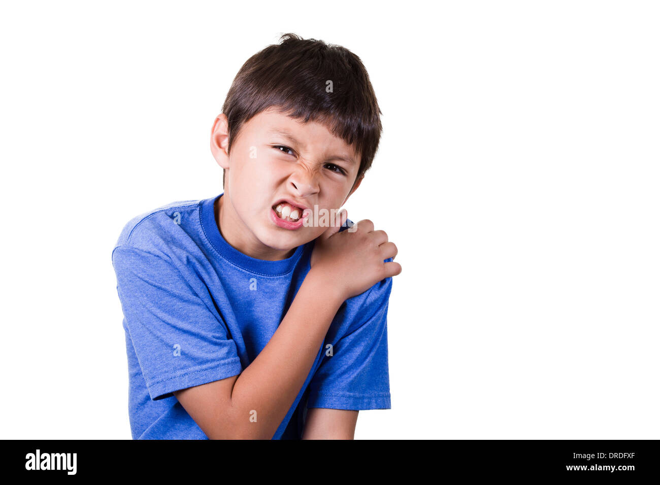 Boy with hurt sprained shoulder - on white background - Stock Image