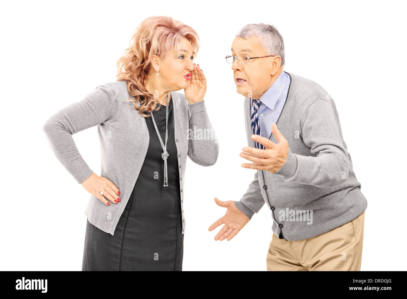Mature lady whispering a secret to man - Stock Image