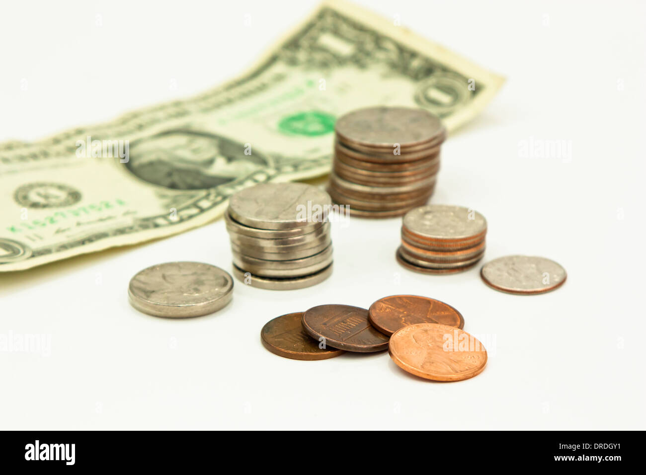 Nickels, dimes, quarters, pennies, dollar bill, US currency. - Stock Image