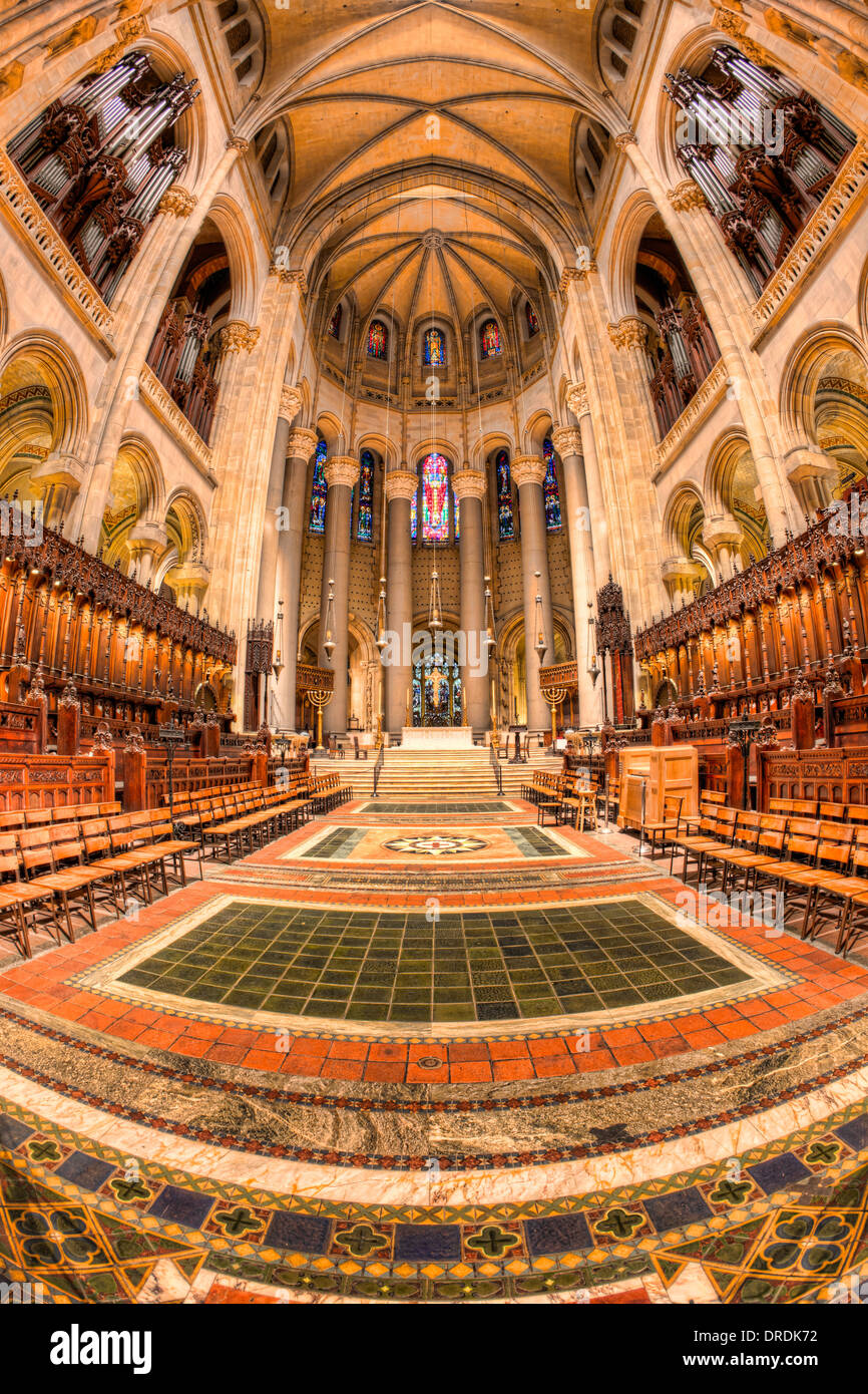 The altar, chancel, and choir seating area inside the Cathedral of Saint John the Divine in New York City. - Stock Image