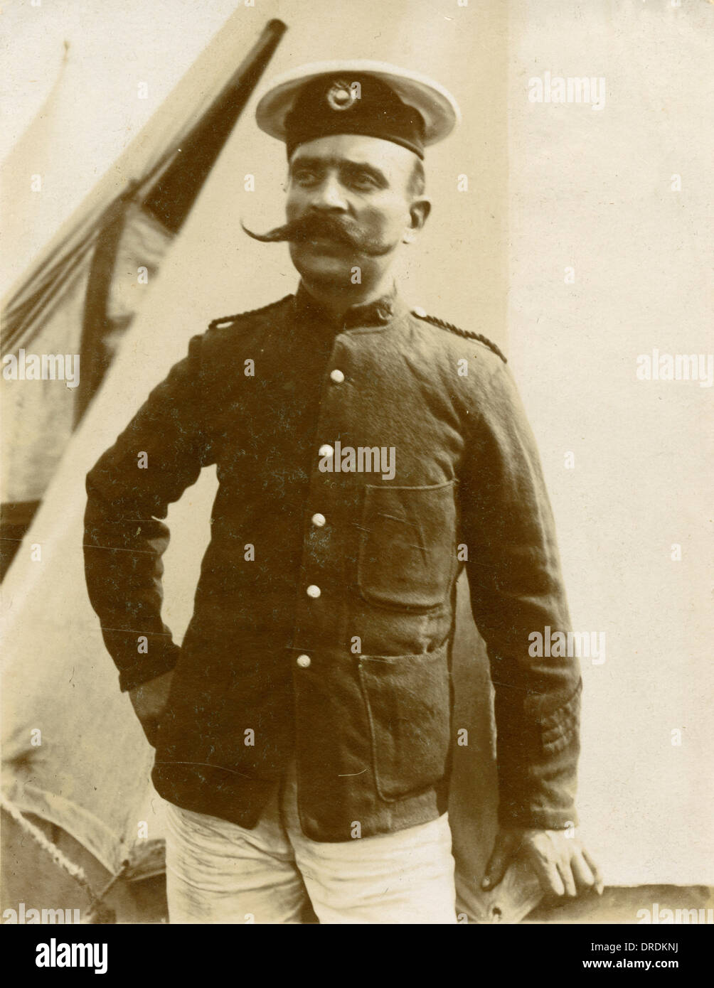 Man in uniform with moustache - Stock Image