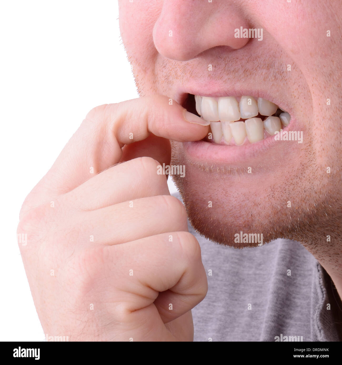 a macro view of biting nails - Stock Image