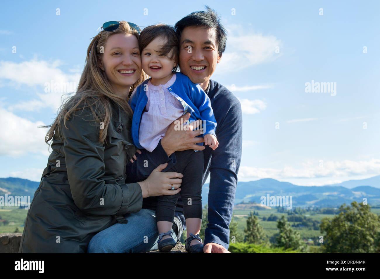 Mixed race family of three - Stock Image