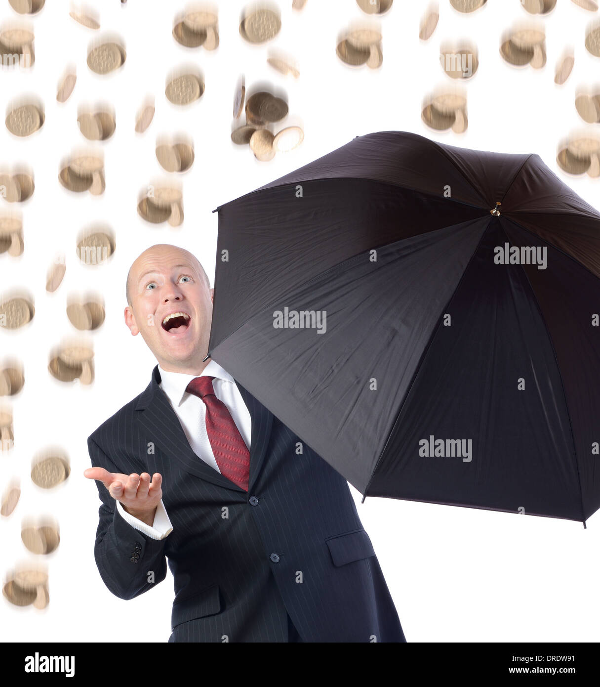 Man in suit with umbrella concept of getting better raining money - Stock Image