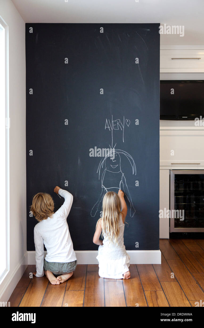 kids writing on chalkboard wall stock photo 66073878 alamy. Black Bedroom Furniture Sets. Home Design Ideas