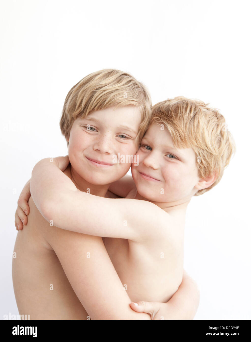 Brothers hugging - Stock Image